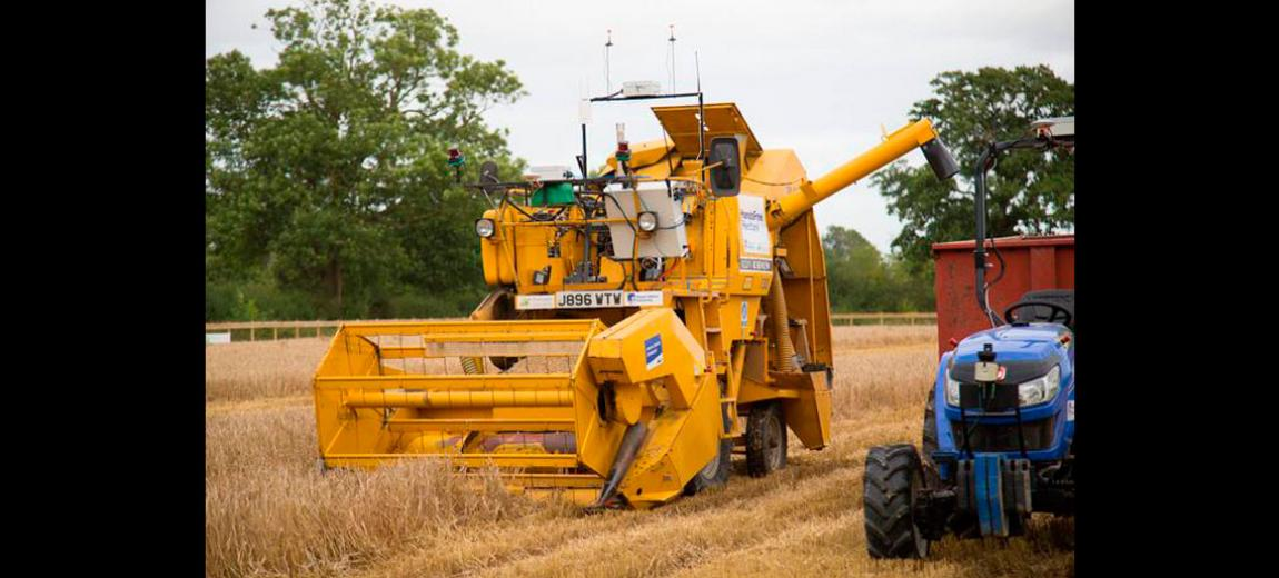 Photo of some farm equipment in a wheat field - Hands Free Hectare (courtesy of Harper Adams University)